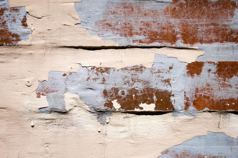 Worn cracked wall with peeling paint and plaster royalty free stock photography