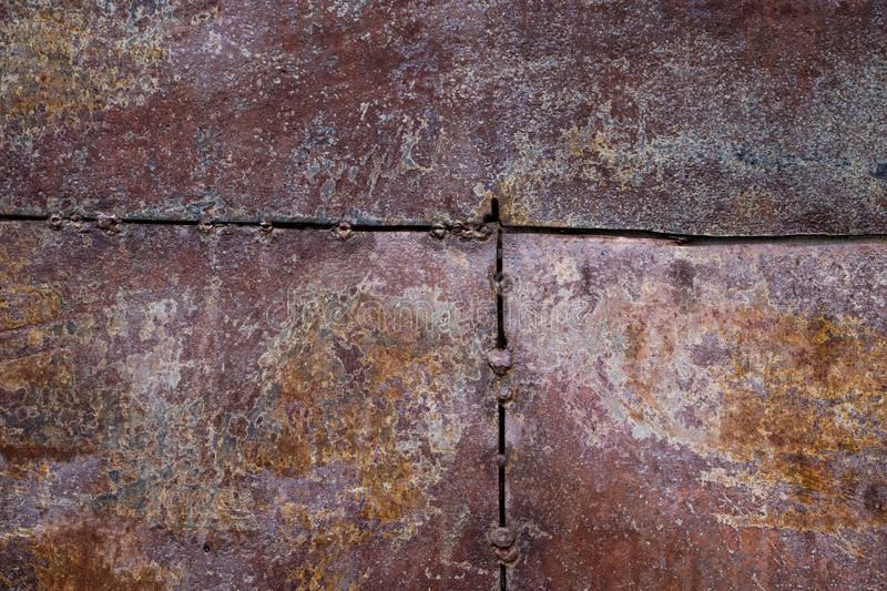 Worn dark brown rusty metal texture background royalty free stock photo