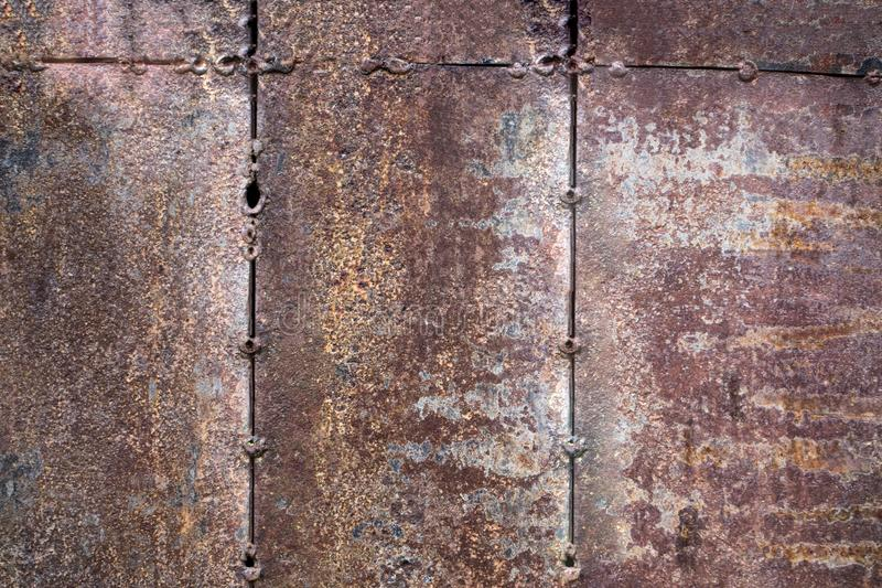Worn dark brown rusty metal texture background. the concept of t royalty free stock images