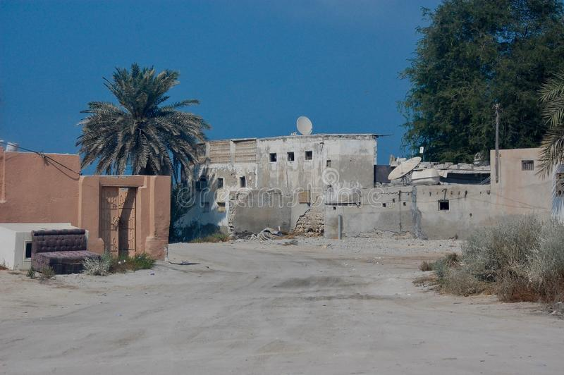 A worn down area of town. Quiet and seemingly empty on a dry, hot day in the middle east. stock photos