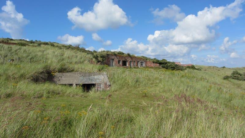 Worn down war bunkers in the dunes.  stock photos