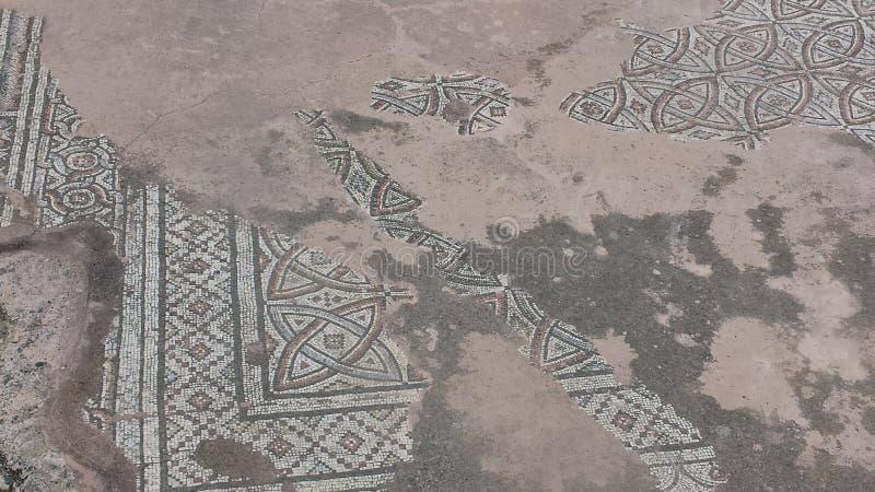 Worn floor mosaic, St Paul's Pillar, Paphos stock image