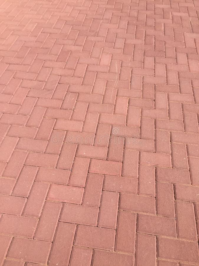 Worn footpath walk textured , red brick block floor. Red brown rectangle shape clay tile floor pattern, brick pavement background. Wootpath walk textured , red royalty free stock images