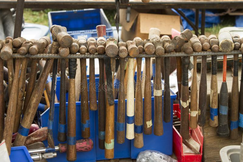 Worn-out hammers hanging on rebar stock photos