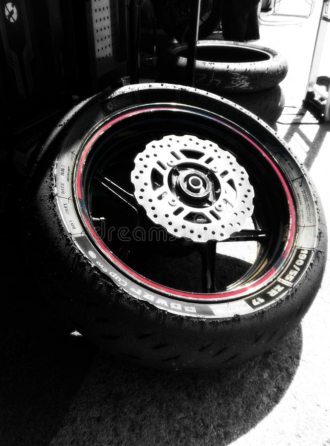 Worn-out motorcycle racing tyre in Jerez Circuit stock photos