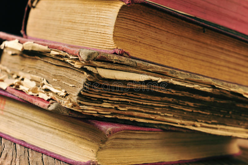Worn-out old books stock images