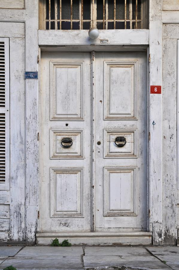 Worn out old wooden white door. Old wooden white door painted in Istanbul Büyükada - Princes Islands royalty free stock photography