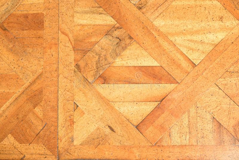 Worn out wooden floor of castle hall. Light wood flooring. Worn by use with defect stock photography