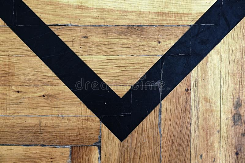 Worn out wooden floor of sports hall with colorful marking lines. stock images