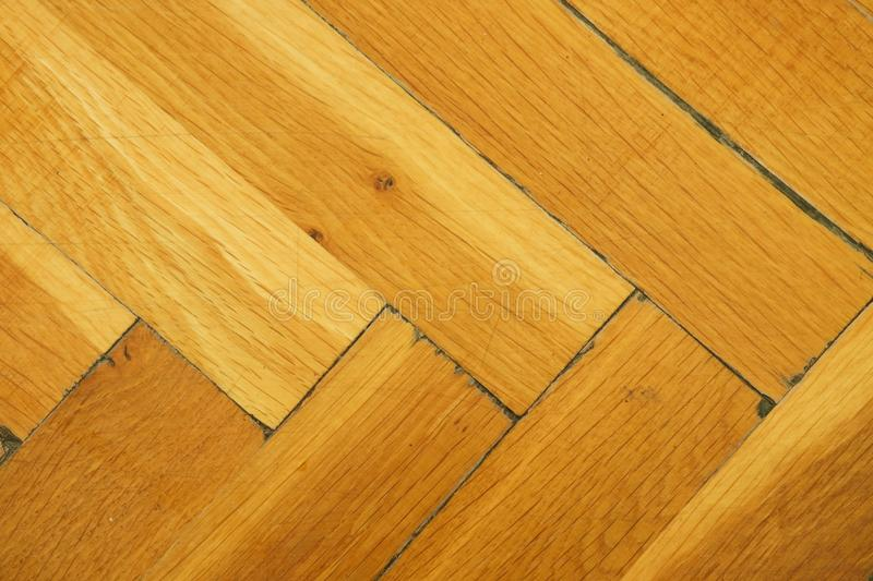 Worn out wooden floor of sports hall. Light wood flooring worned by use and time. Worn out wooden floor of sports hall. Light wood flooring worned by use with stock photos