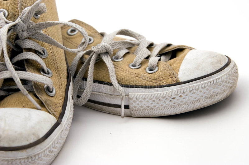 Worn Pair of Sneakers stock image