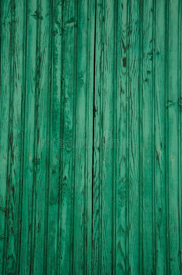 Worn planks of wood in an old green door. Close-up of worn planks of wood in an old green door forming a singular background, in a sunny day at Unhais da Serra stock photo