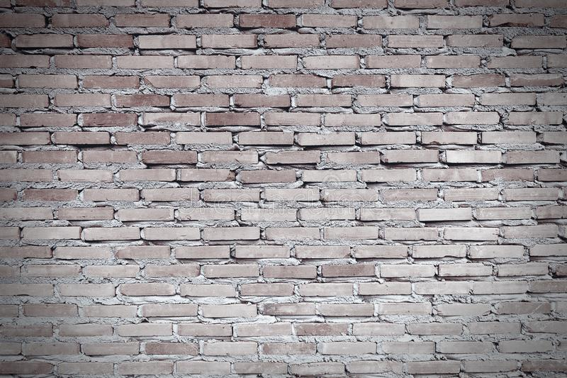 Worn red brown brick wall. The facade of an industrial building. Monochrome image. Abstract banner. royalty free stock photo