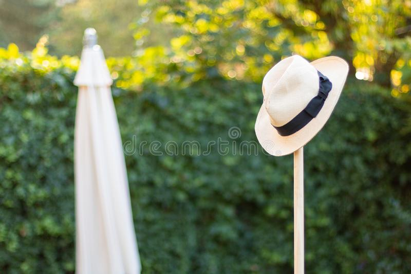 Worn Straw Hat on a Garden Tool Concept Shot for gardening, rest, work done royalty free stock images