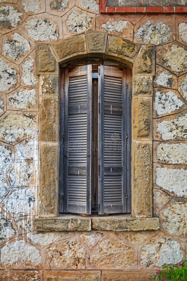 Worn wooden window on an abandoned house stock image