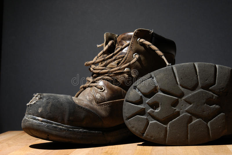 Worn Work Boots. A pair of worn work boots showing their texture royalty free stock photo