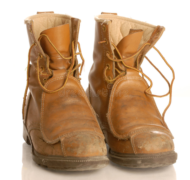Worn work boots. Or safety boots isolated on white background stock image