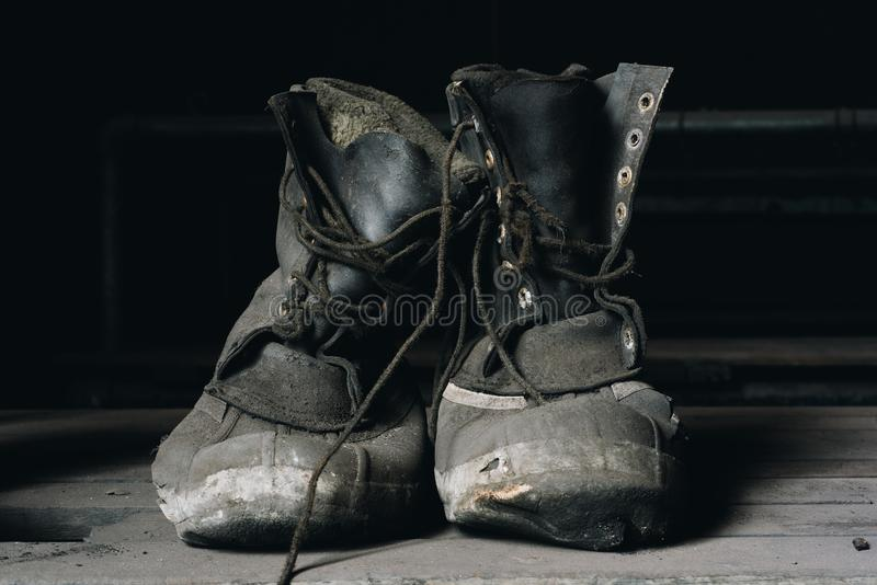 Worn Work Boots - Abandoned St. Nicholas Coal Breaker - Pennsylvania. A view of well worn work boots inside the now demolished formerly abandoned St. Nicholas royalty free stock images