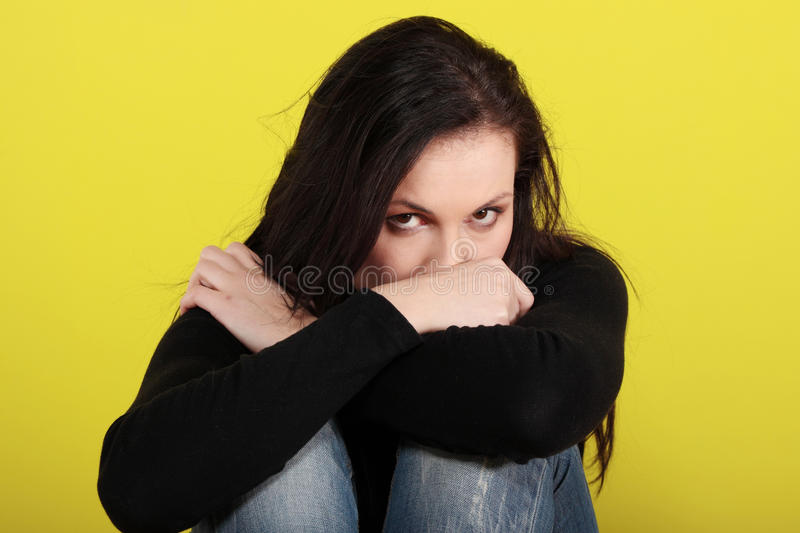 A worried and afraid young woman royalty free stock images