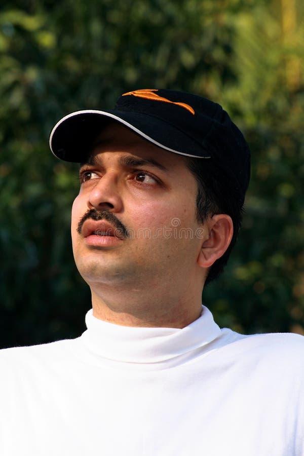 Download Worried Asian Sportsman In Cap Stock Photo - Image: 3754874