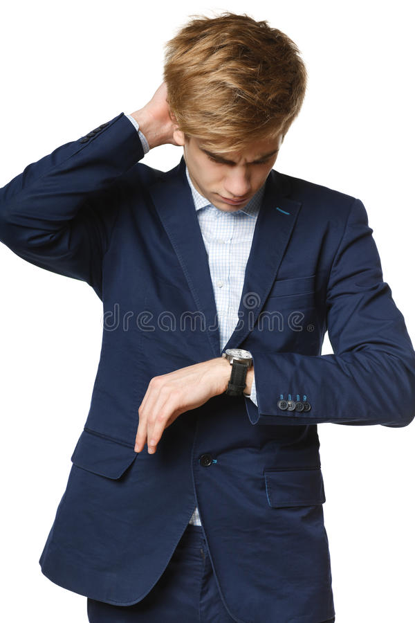 Worried business man looking at wrist watch. Over white background royalty free stock photos