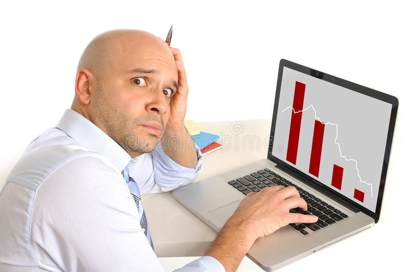 Worried business man in stress watching sales and finance collapse royalty free stock photo