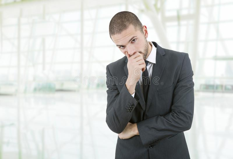 Business man. Worried business man thinking at the office stock photo