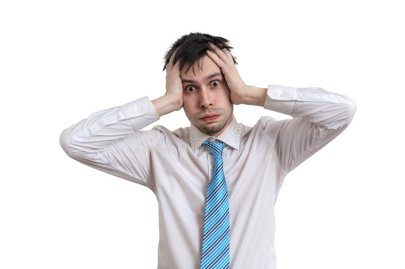 Worried businessman is holding his head. Isolated on white background. stock photos