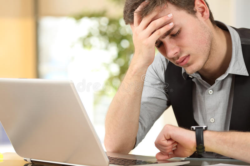 Worried businessman running out of time royalty free stock photo