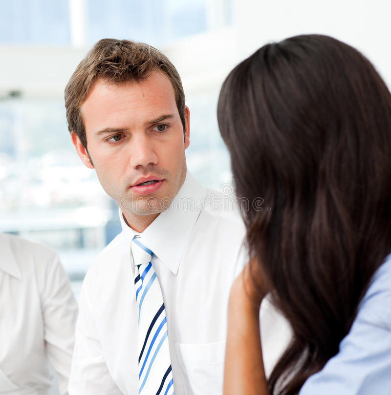 Worried businessman talking with his partner stock photos