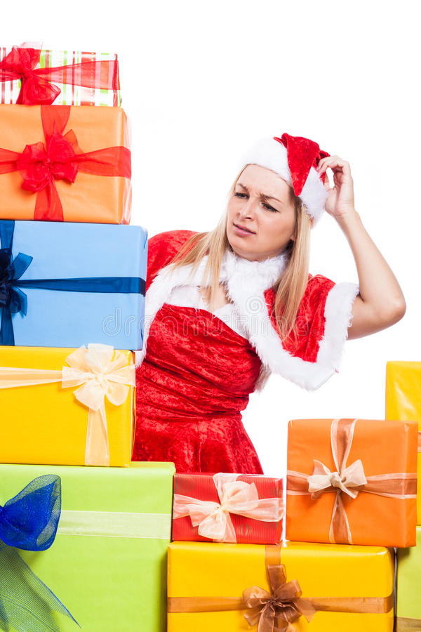 Download Worried Christmas Woman Looking At Presents Stock Photo - Image: 33451746