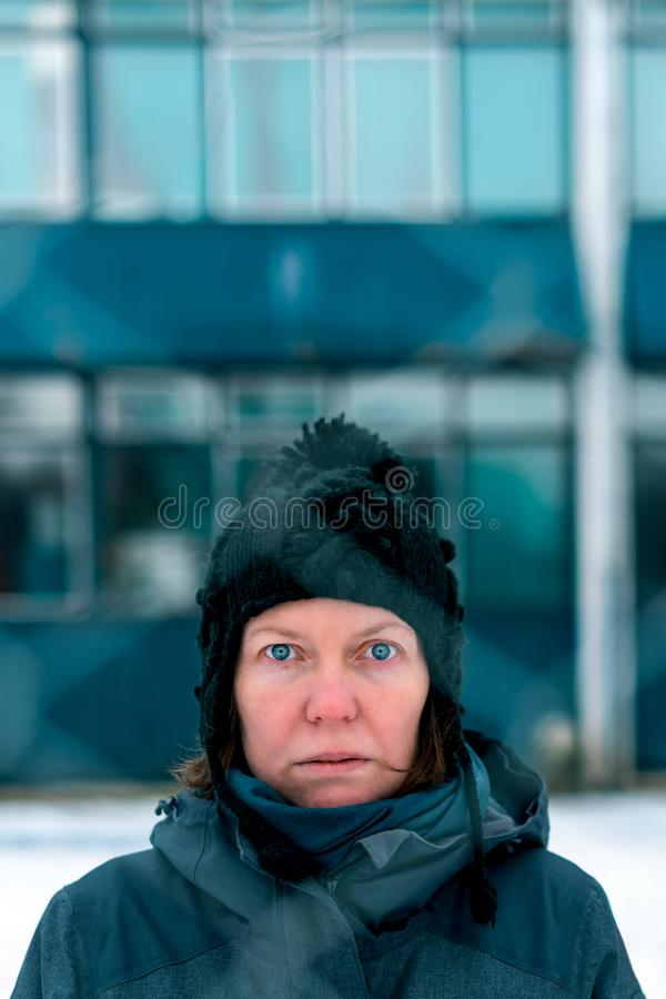 Worried concerned serious woman behind chain-link fence royalty free stock photos