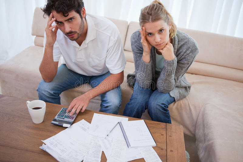 Worried couple doing their accounting royalty free stock photo
