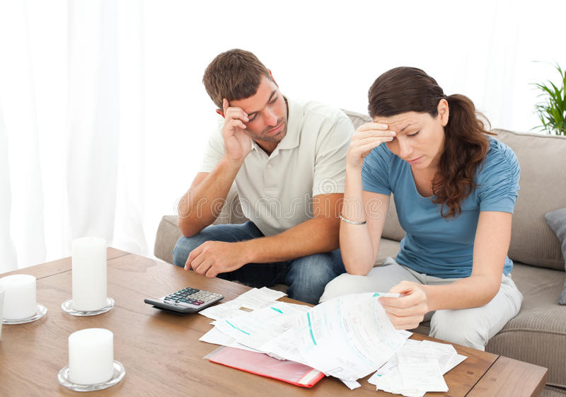 Worried couple doing their accounts royalty free stock images