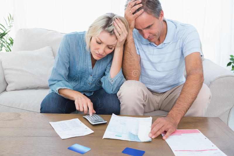 Worried couple going over finances royalty free stock image