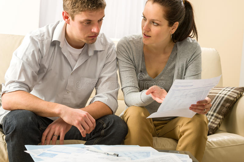 Worried couple talking about their expenses royalty free stock photo