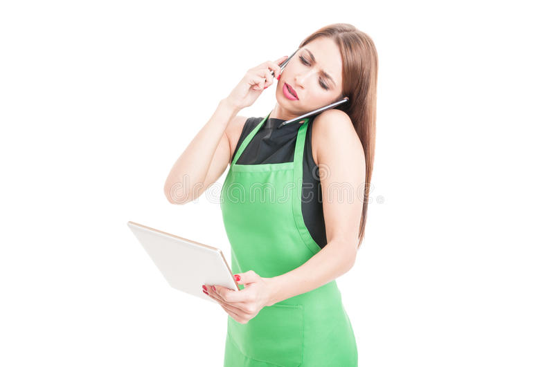 Worried employee calling somebody and holding tablet stock photos