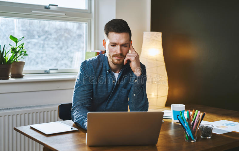 Worried entrepreneur young man working at desk royalty free stock photos