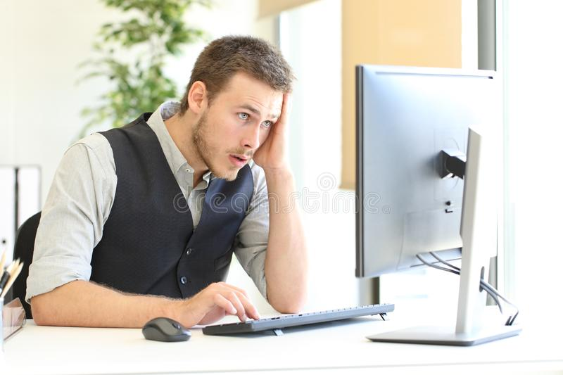 Worried executive discovering mistake on computer. Worried executive complaining after discover mistake on computer at office royalty free stock photos