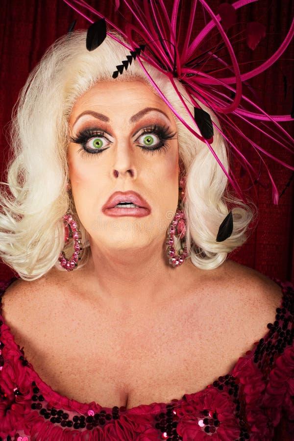 Worried Female Singer. Worried man dressed as blond female singer royalty free stock images