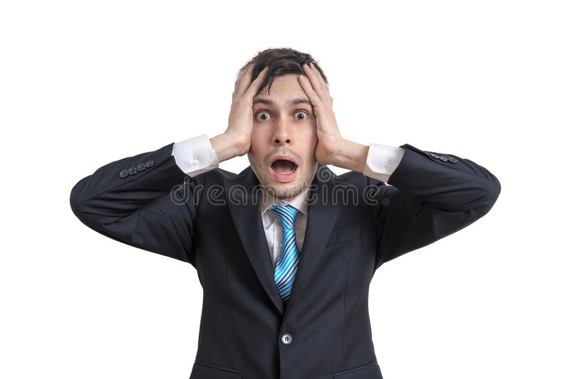Worried funny businessman is holding his head. Isolated on white background. stock photography