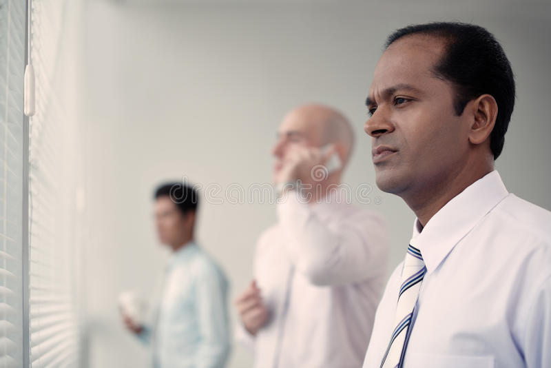 Worried Indian businessman stock image