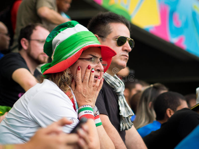 Worried Iran Fan Watching World Cup Match Against Bosnia Herzegovina. Worried Iran fan watching FIFA World Cup football match against Bosnia and Herzegovina at royalty free stock photography