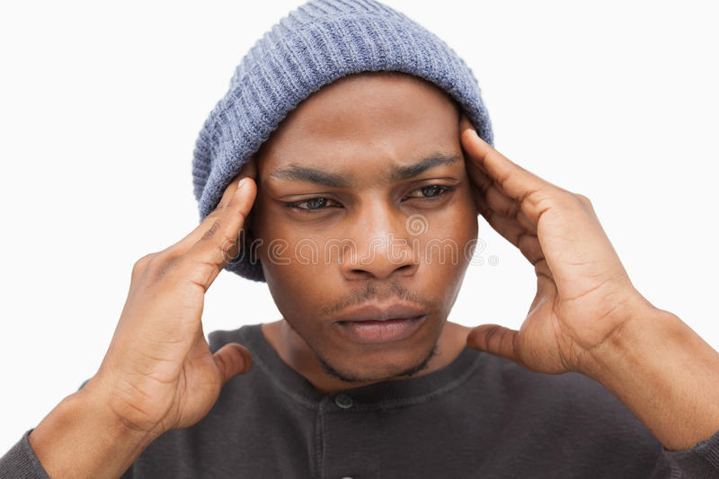 Worried man in beanie hat. On white background royalty free stock photo