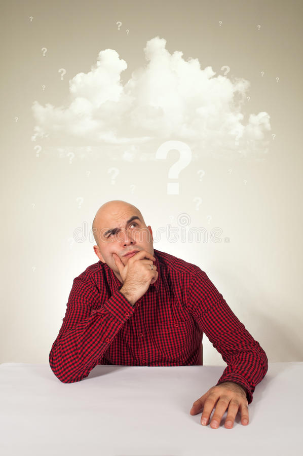 Worried man with lot of questions royalty free stock photography