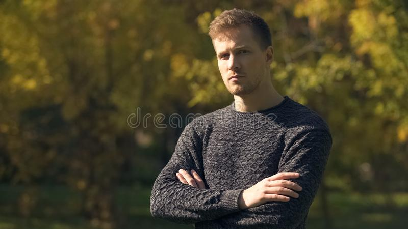 Worried man nervously looking at camera, difficulties at work, unemployment. Stock photo stock photography