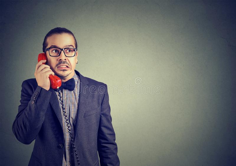 Worried man receiving bad news on phone royalty free stock images