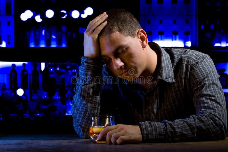 Worried man sitting at bar stock photos