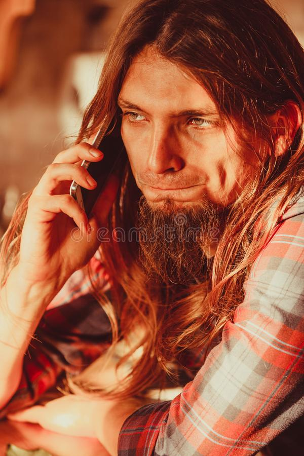 Worried man talking on mobile phone. Disappointment and depression. Unrequited love concept. Young worried disappointed man talking on smartphone mobile phone stock photos