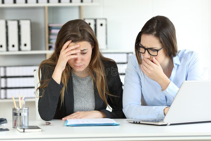 Worried office workers discovering a mistake. In a document royalty free stock images